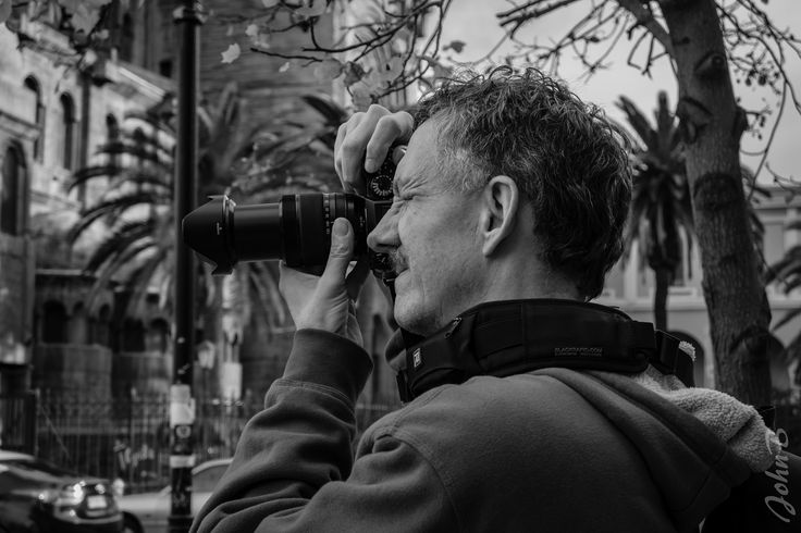 https://flic.kr/p/UBzTJa   John con camara by Xime - XM1 - May 13 2017   A photo that my wife, Ximena, took of me with my Fujifilm X-T2 camera and an XF18-135mm F3.5-5.6 R LM OIS WR lens as we were walking around in Santiago.  She took it with her Fujifilm X-M1 camera paired with a FUJINON XC 16-50mm F3.5-5.6 OIS lens