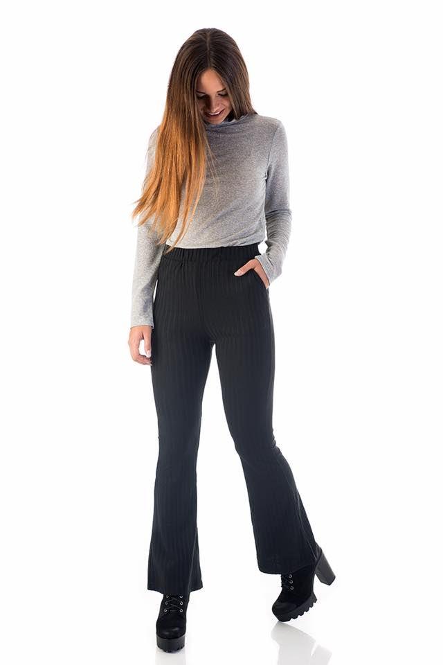 Regular fit. Hiphuggers elastic flared trousers with stretch waist. 95% Polyester. 5% Elastane. https://www.modaboom.com/efarmosto-panteloni-me-kampana.html