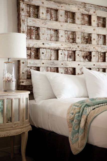 I want to try!!!! I'll bet you could do this yourself with pallets or reclaimed wood.  Wonder what the iron screw eye is used for (in the middle of the headboard)???