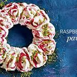 Impress your guests this festive season with this wreath-themed pavlova sprinkled in pistachios and complete with a raspberry swirl.