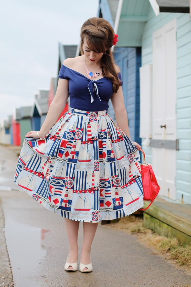 A retro style nautical outfit featuring a cute lighthouse print skirt from Hell Bunny