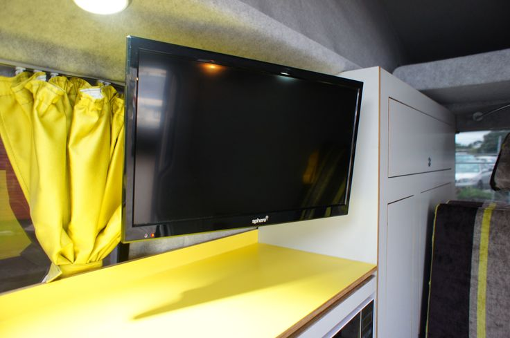 Flatscreen TV with inbuilt DVD player in retro Achtung Camper campervan conversion to VW T5.