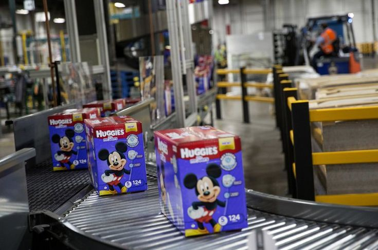 The maker of Huggies and Kleenex will lay off as much as 13 percent of its staff in an effort to reduce costs.
