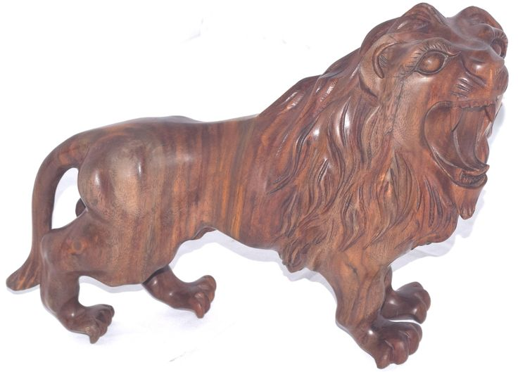 This+powerful+walking+lion+statue+looks+like+a+real+hand-crafted+wood+carving+but+it+is+actually+made+of+polyresin.+It+is+handpainted+with+excellent+detail+and+craftsmanship