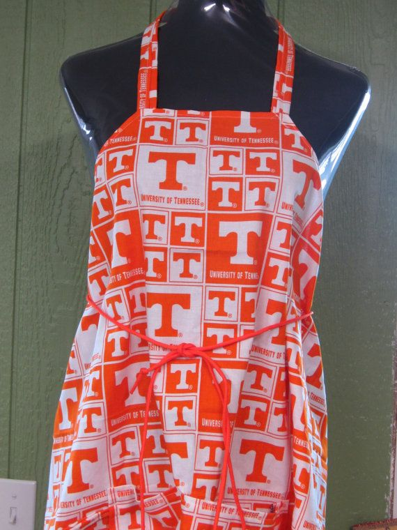 This one size fits all #apron is available in #camo or University of TN.  It features a large pocket, a pocket for a beer bottle and a hoop to hold tongs. #sellertools #clothing #kitchen #man #woman #hunting #girl #boy #gift #grill