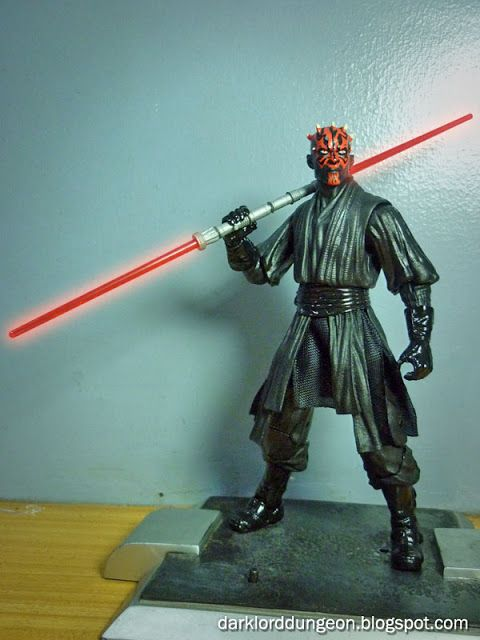 "Star Wars Black Series Darth Maul's blister pack reads a simple ""The Evil Sith Apprentice Darth Maul engages in a fierce lightsaber duel with Qui-Gon Jinn and Obi-Wan Kenobi. 'At last we will reveal ourselves to the Jedi. At last we will have revenge.'"""