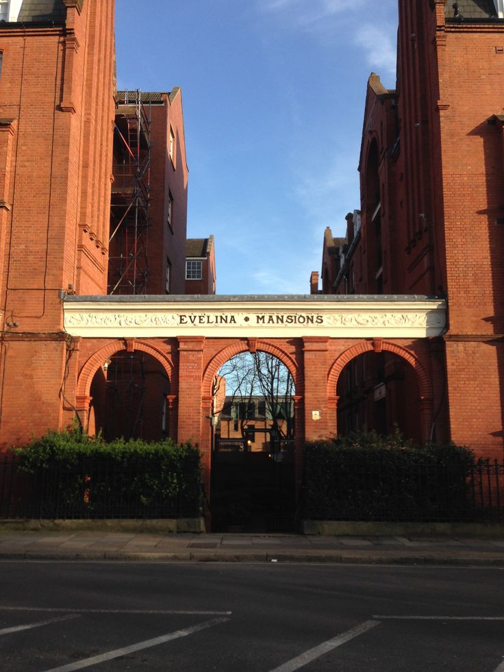 Arched entrance to Evelina Mansions, Southwark, London.