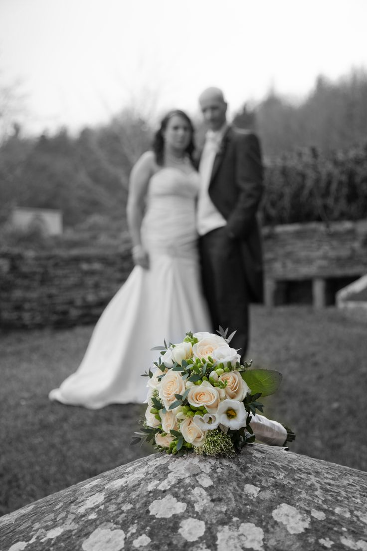 Thanks to Gary and Katie for the picture. The bouquet is a collection of vendella roses white lisianthus, freesia, trachelium and greenery.
