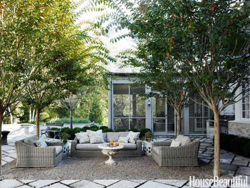 Jeanette Whitson | House Beautiful; pea gravel patio with trees surrounding sitting area