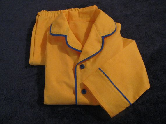 Classic pajamas inspired by Polar Express! Yellow pajamas with royal blue piping and buttons.