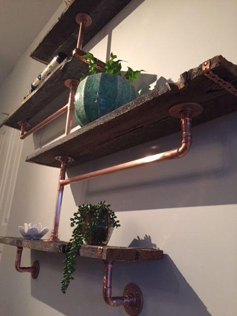 Copper pipe and reclaimed barn boards... brilliant!