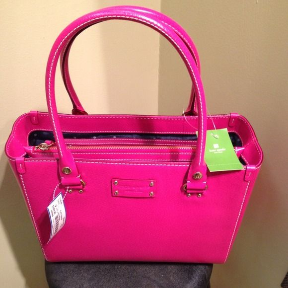 A Kate Spade purse for sale!!! This Kate spade is a pink WITH THE PRICE TAGS STILL ON IT!!! kate spade Bags