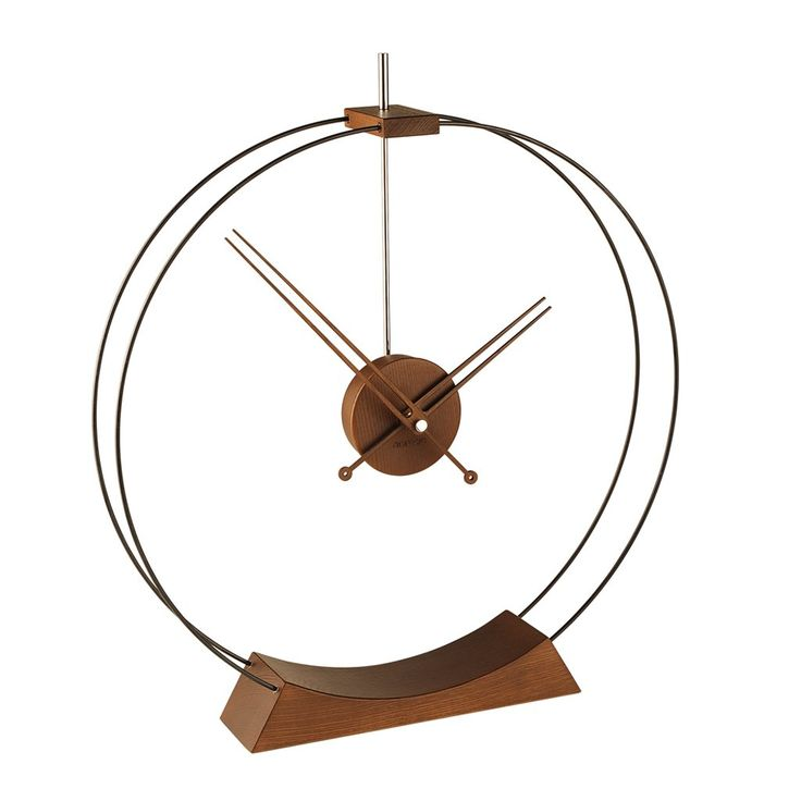 """Through a combination of design reference to old traditions and renewed aesthetics, the Aire table clock brings serene elegance and timeless style.The lightness of the outer fiber circles is well-balanced by the solid walnut base. The clock is available in chrome and is handmade.19.75"""" Diameter x 22.25""""HMechanism: UTS Quartz (Germany)"""