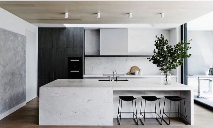 Scandinavian kitchen design featuring marble | wood accents | monochrome