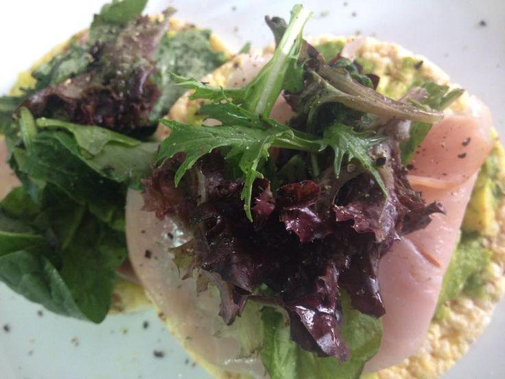 Tasty lunch snack. Ham, avocado lettuce on rice thins