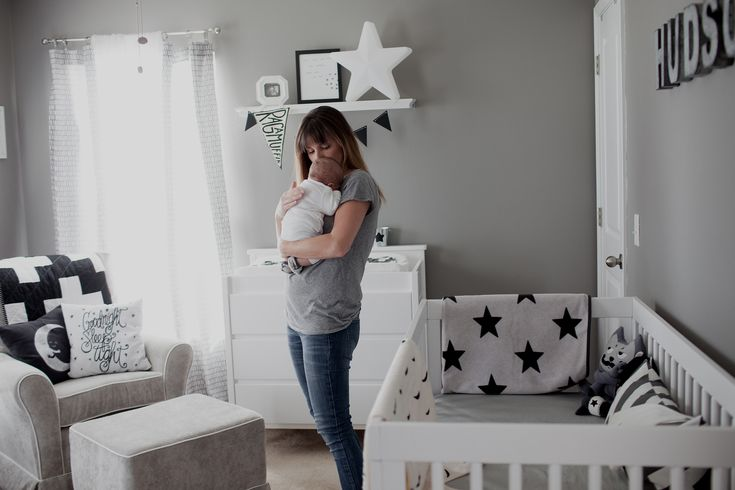 Black and White Nursery Modern Nursery - great mix of pattern and shades to add interest to this monochromatic space!