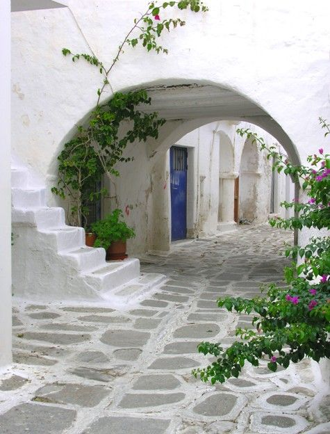 Old stone alley in Paros, Greece.    I was there. I love Paros!