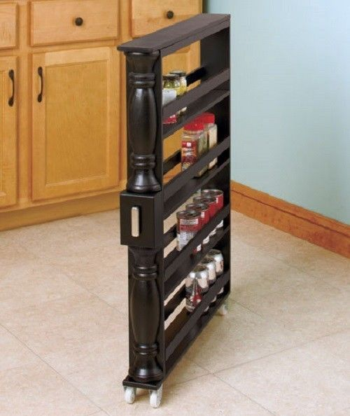 "Allow more kitchen storage space with this Pull-out Cabinet Spice Rack. Nearly 3 feet tall, 3-1/2 inches wide, designed to fit in between appliances, cabinets and narrow spaces right in the kitchen. Simply pull out this specially designed spice rack whenever you need. The open shelves can securely hold spice jars, soda cans, and other small items. Simple assembly required. Details: 34 1/4"" x 25 1/4"" x 3 1/2"" Tall, Slim design on Wheels Stores many items for more space Wooden"