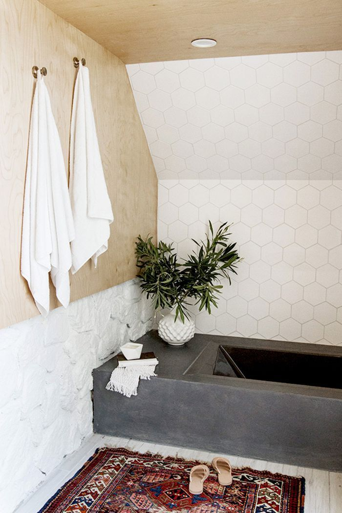 Ahead are 15 tiled bathrooms that might just make you fall out of love with wallpaper.