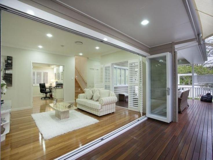 Queenslander - beautiful concertina doors, timber floors and staircase