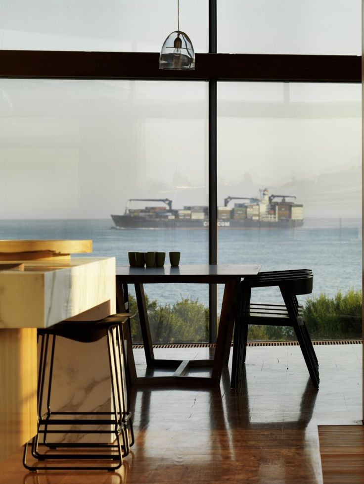 Queenscliff Material / John Wardle Architects  The dining space and kitchen overlook the activities of the bay.