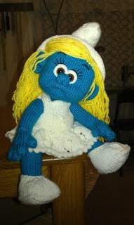 Knitted Smurfette doll.