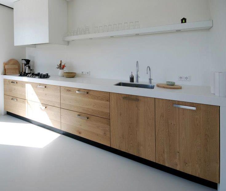 wood lower cabinets with hardware- white hood- white shelf