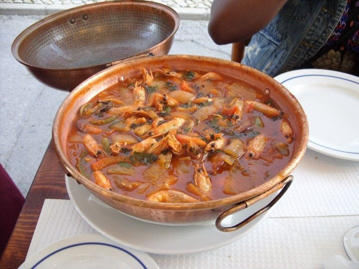 Portuguese dish called Cataplana. Filled with prawns, clams, chorizo ...