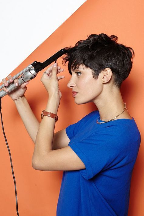 """Hey, Shorty: 4 Rad 'Dos For Pixie Cuts #refinery29  http://www.refinery29.com/55218#slide2  Start with completely dry hair and brush it all forward. Do not make a part. To get a beautifully wavy texture, wind your hair around a half-inch barrel curling iron (wrap every section of hair that's longer than one inch). Start halfway down the hair shaft and go all the way to the ends. """"Don't be afraid if it looks like a bunch of curly-Qs at first,"""" says Brill. """"You want the hair to be really ..."""