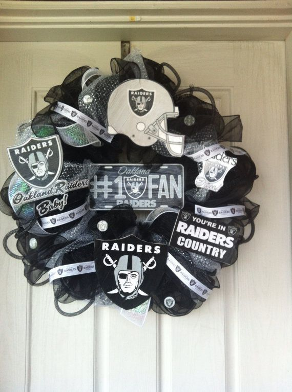 Hey, I found this really awesome Etsy listing at http://www.etsy.com/listing/117257738/oakland-raiders-deco-mesh-wreath
