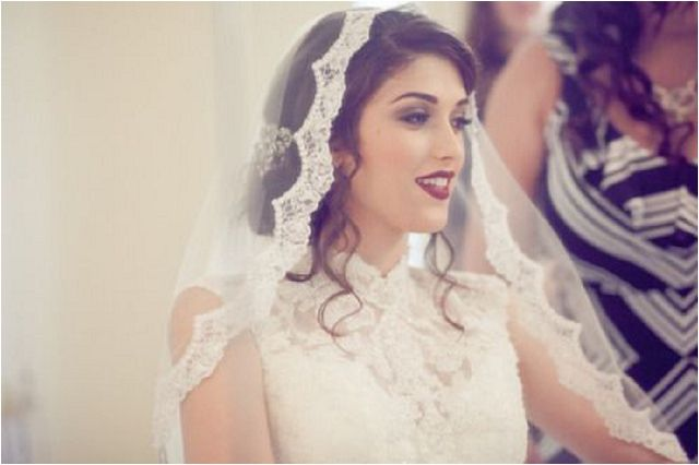 Wearing a mantilla at the top of the head gives you a very traditional look and allows the lace to drape nicely on the sides of the face and over the shoulders. The key to getting this look right is to place the edge of the veil 2 inches back from the hairline