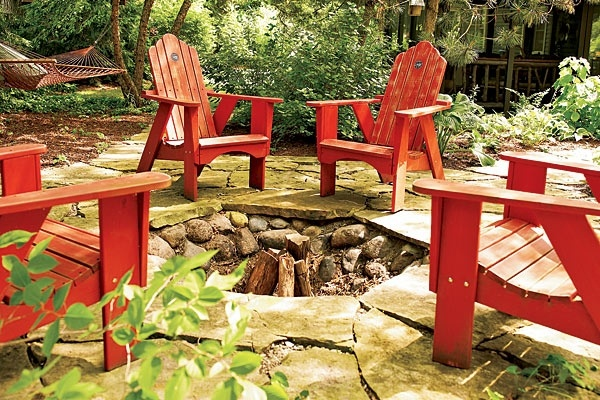 Red Adirondack Chairs Provide Seating Around The Fire Pit