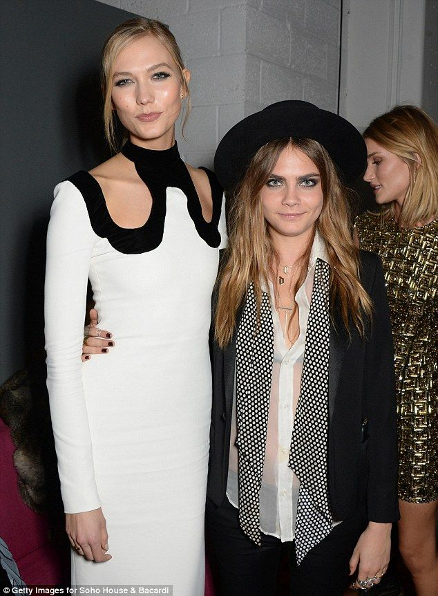 That's a tall order! Karlie - who's 1.85 metres tall - inadvertently made Cara, who's 1.77 metres, look tiny