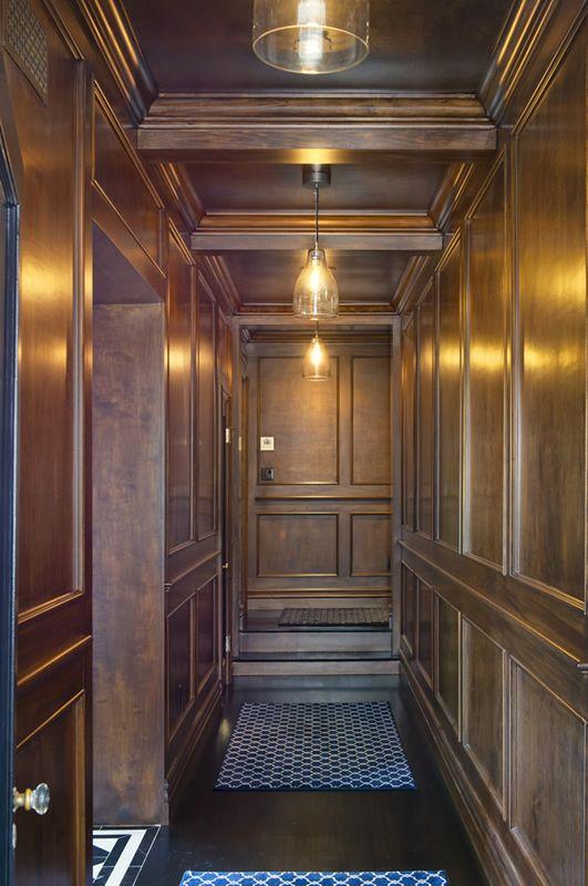 Jeff Lewis - Paneled hall with pendant lighting