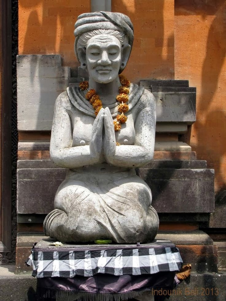 Bali statue in Nyuh Kuning on Ubud's southern outskirts. She sits to one side of the entrance, welcoming visitors, and her husband sits on the other side. © Indounik Bali 2013 #Bali #statues #carving #Bali #Indonesia