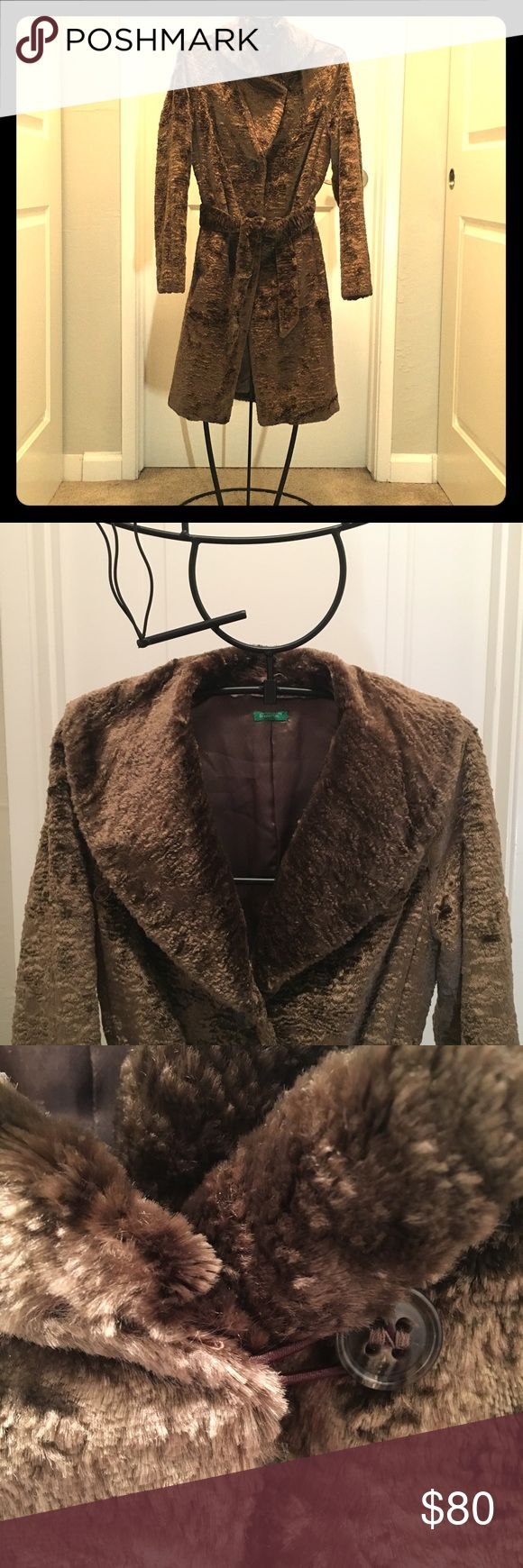 Benneton Faux Sheared Lamb Coat Astonishingly warm and cozy coat. It's the softest thing we've ever touched. Shawl collar is adjustable, as pictured. Varies between brown and notes of gold, depending on which way the fur is smoothed down. 67% viscose and 33% cotton. Gently used with no defects. ✨ We're happy to negotiate the price! United Colors Of Benetton Jackets & Coats