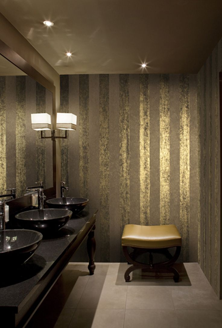 The gold foil wall covering looks luxury, especially under the light.
