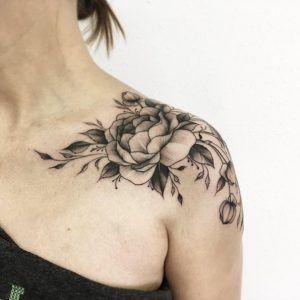 Elegant peony tattoo on shoulder by Vitalia Shevchenko
