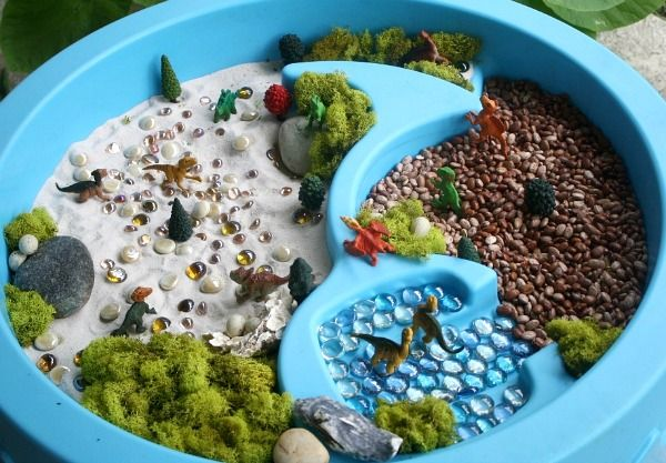 Small Worlds in the Water Table: I love how the natural materials (like that gorgeous moss) were incorporated into the scene.  This is so inviting, I'd have to settle in and join my kiddos with this one!