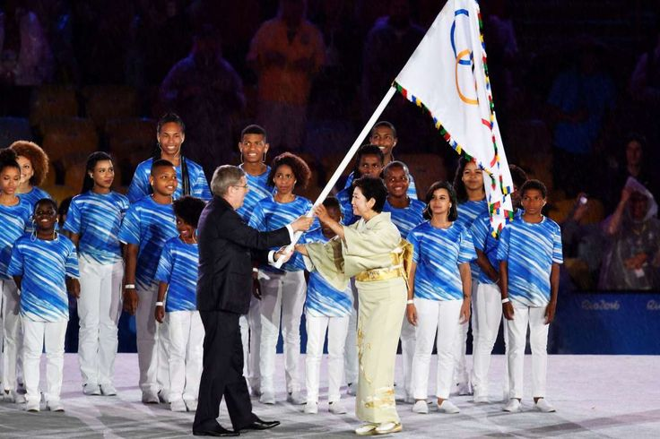 Tokyo's turn International Olympic Committee President Thomas Bach, left, gives the Olympic flag to Tokyo governor Yuriko Koike on Aug. 21 in Rio de Janeiro. Tokyo will host the 2020 Summer Olympics.