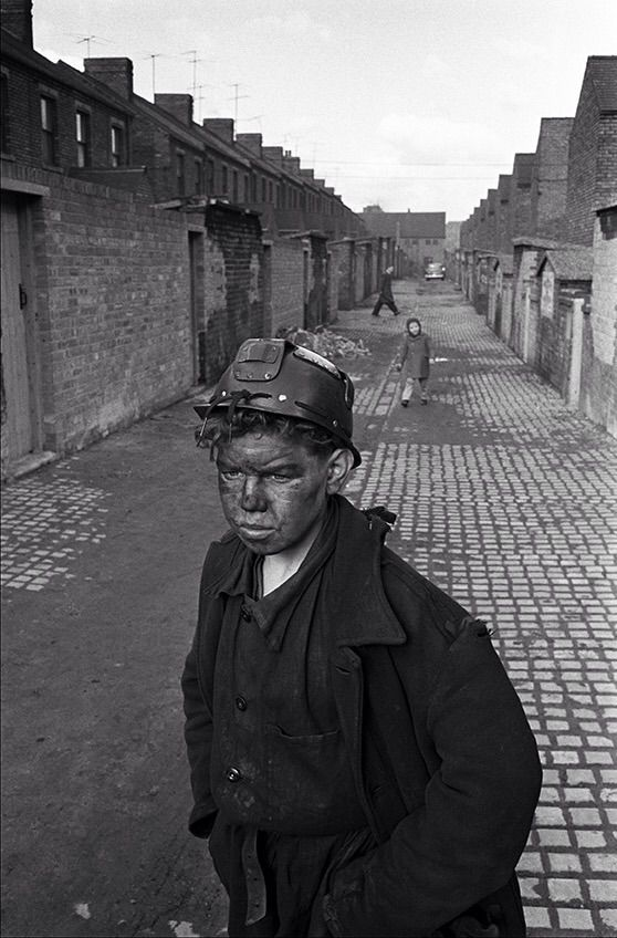 A young miner returns home from his shift at the Horden coal mine, County Durham, (1960s).      Photograph by Patrick Ward.