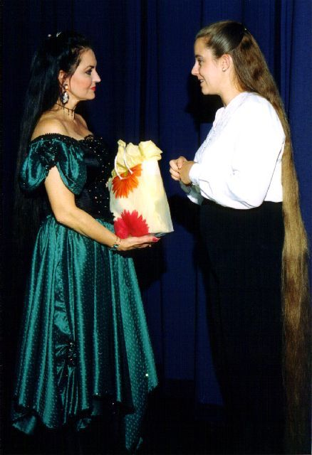 Crystal Gayle And A Woman With Long Blonde Hair Down To