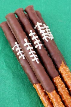 Party Food Ideas Perfect for Super Bowl - Super Bowl Party Recipes - Chocolate Pretzel Football Rods - This salty n' sweet snack looks like more work than it actually is–which means you should go ahead and make 'em. Get 49 other Super Bowl snack ideas at http://redbookmag.com.