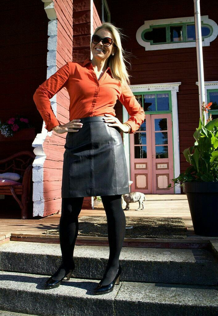 Black leather miniskirt black nylons heels orange blouse outfit