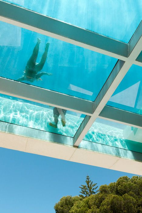This house features an elevated swimming pool with a glazed underside
