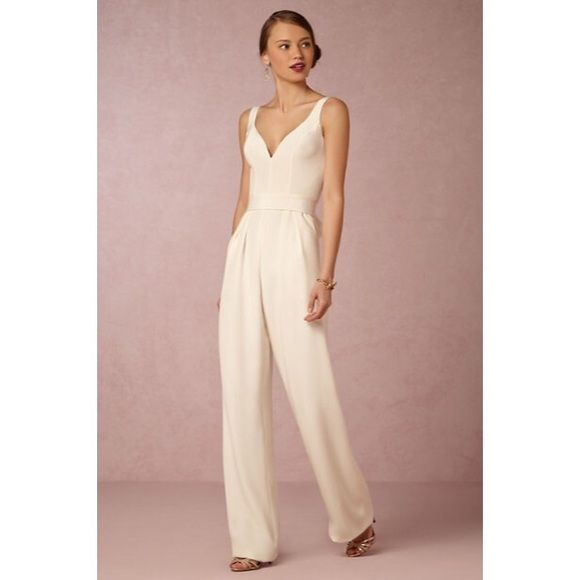 Aurore Jumpsuit by Jill Jill Stuart from BHLDN Jumpsuit by Jill Jill Stuart exclusively for BHLDN. Effortlessly feminine and with a bold silhouette, this ivory jumpsuit is perfect with delicate jewelry & bold heels. Great for the modern bride or for a special evening! This is labeled a size 6 but it's been altered to be a 4. No longer available in stores! Worn once. - A BHLDN exclusive - From Jill Jill Stuart - Crepe sash shown in picture not included - Side pockets - Polyester crepe…