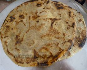"""Bajra na Rotla / Millet Thick Roti an Authentic Gujarati Pancake like thick Roti/Bread made of millet flour and rolled over using palms....Although absolutely simple to make, these rotis are delicious! People in Gujarat  love to eat them with fresh white butter and jaggery especially in winter season. Here goes the recipe of Bajra na Rotla...  Millet  a tiny """"grain like seed"""" is gluten-free and packed with vitamins,minerals, calcium, fiber and iron. Acts as a prebiotic and..."""