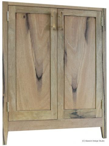 Front of one cabinet showing the closely matched grain of the Marri within the frame an panel doors