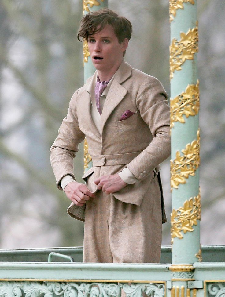 Right after his Oscar win for The Theory of Everything, a picture of Eddie Redmayne in The Danish Girl was released. It was a peek at what Redmayne will look like in his next film as Lili Elbe, the first known transgender woman to successfully undergo sexual reassignment surgery in the early 1900s. Now we have an even better idea of his transformation, thanks to pictures on the set of the film taken in Brussels, Belgium, and Copenhagen, Denmark.