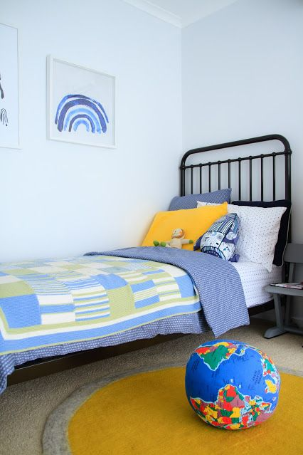 Boysroom with mustard yellow rug and pillowcase giving an extra warmth and colour.  Fine Little Day rainbow print, Incy Interiors Bed, CamCam Bedlinen.  Styling by Little Nook Interiors